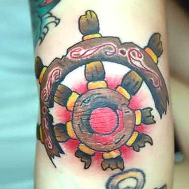 Helm on Elbow Tattoo