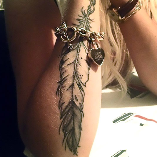 Indian Feather on Arm Tattoo Idea