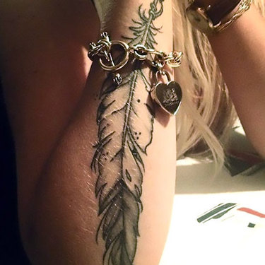 Indian Feather on Arm Tattoo