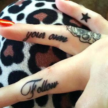 Inner Finger Tattoo