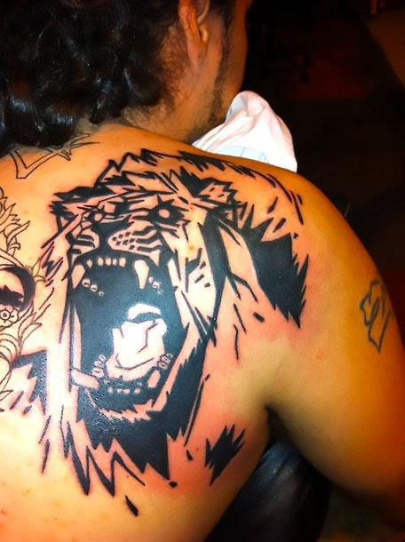 Angry Lion on Shoulder Blade Tattoo Idea