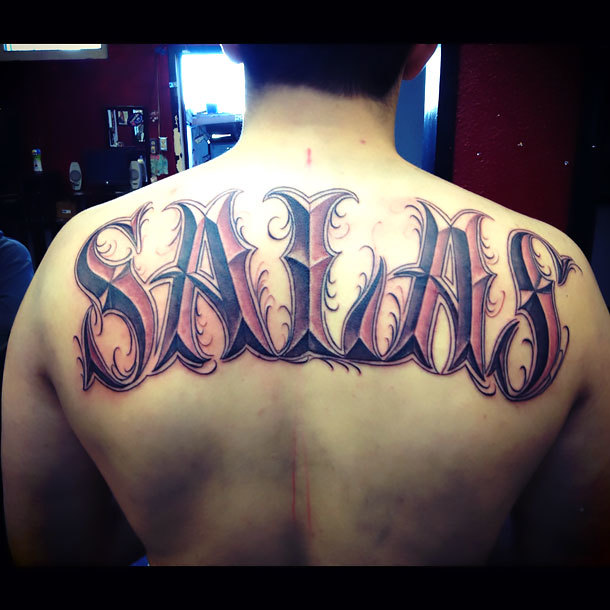 Last Name on Back Tattoo Idea
