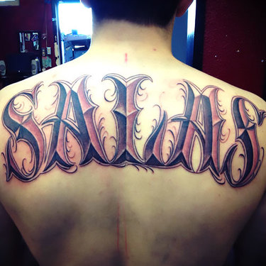 Last Name on Back Tattoo