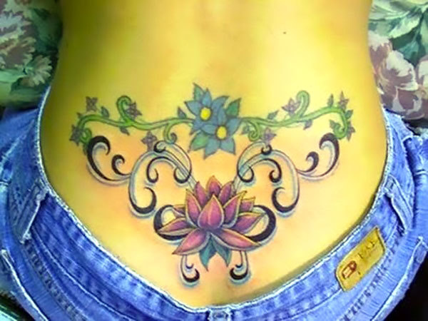 Lotus on Lower Back for Women Tattoo Idea