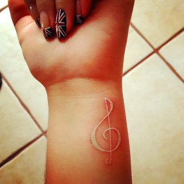 White Ink Treble Clef Tattoo
