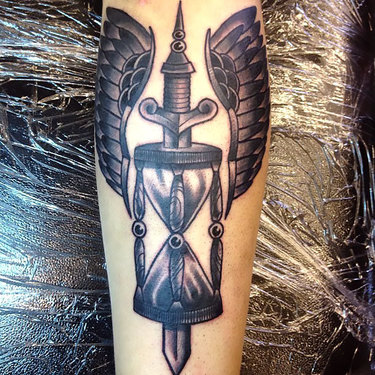 Winged Hourglass on Shin Tattoo