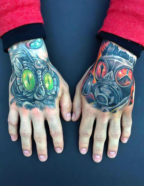 Masks on Hands Tattoo Idea
