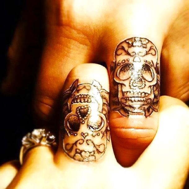 Matching Sugar Skulls on Finger Tattoo Idea