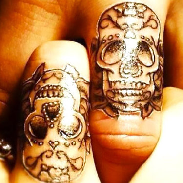 Matching Sugar Skulls on Finger Tattoo