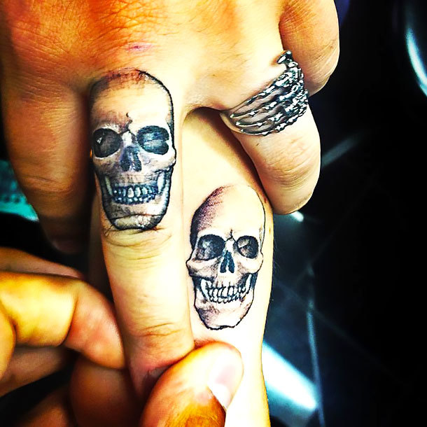 Matching Skulls on Middle Finger Tattoo Idea