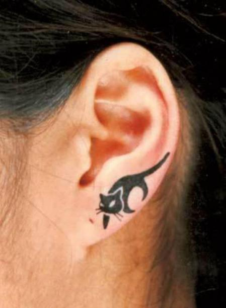 Tiny Cat on Ear Tattoo Idea