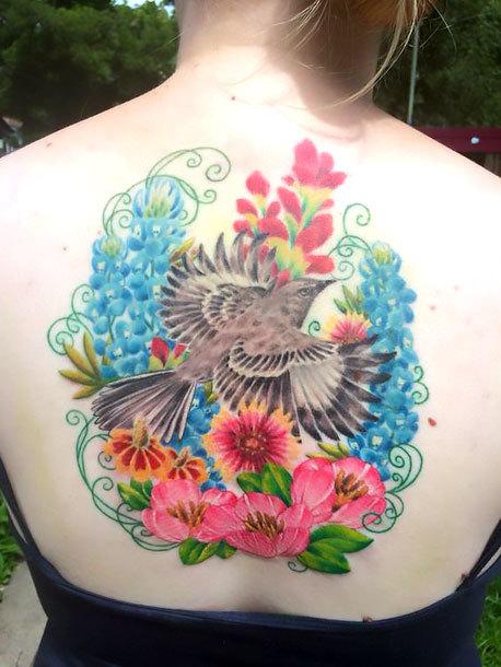 Mockingbird In Flowers Tattoo Idea