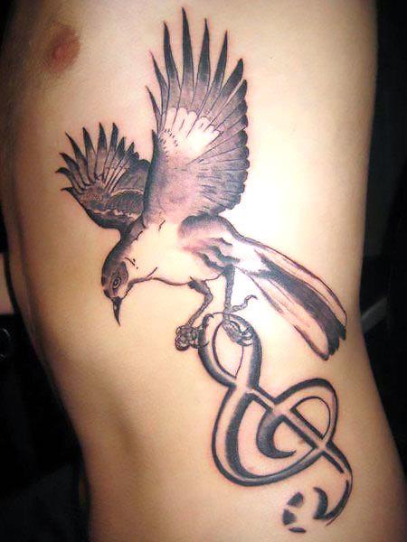 Mockingbird With Treble Clef Tattoo Idea