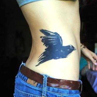 Awesome Blackbird on Side Tattoo