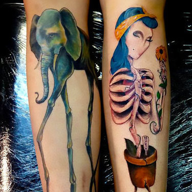 Surrealistic Elephant on Calf Tattoo