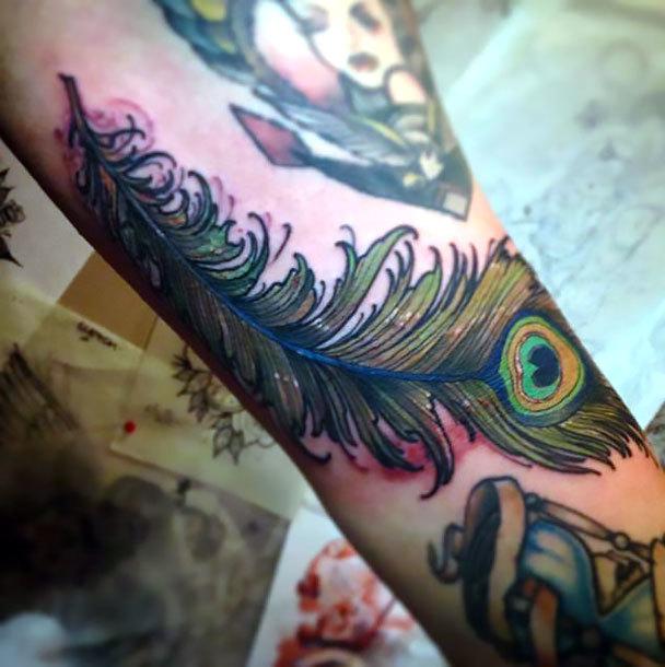 Neo Traditional Peacock Feather Tattoo Idea