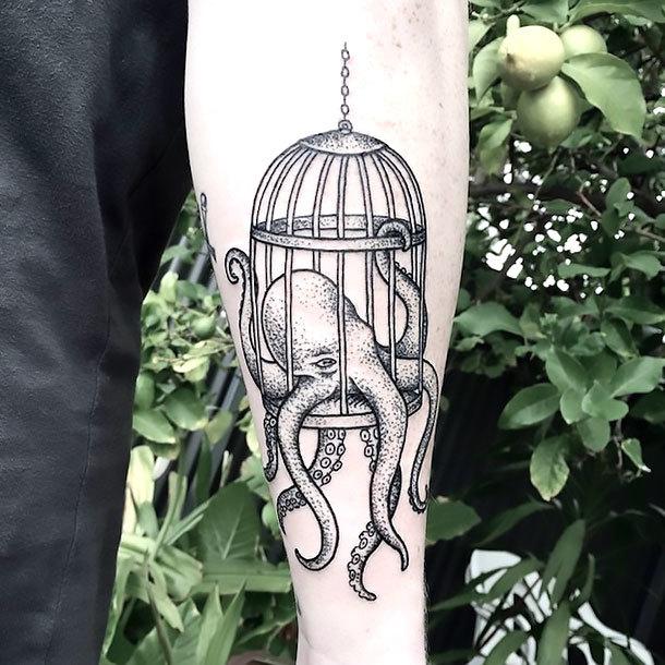 Octopus In Birdcage Tattoo Idea