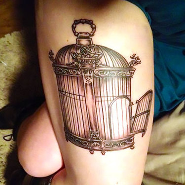 Opened Birdcage on Thigh Tattoo