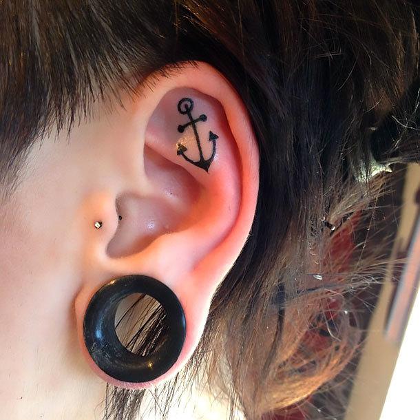 Tiny Anchor on Inner Ear Tattoo Idea