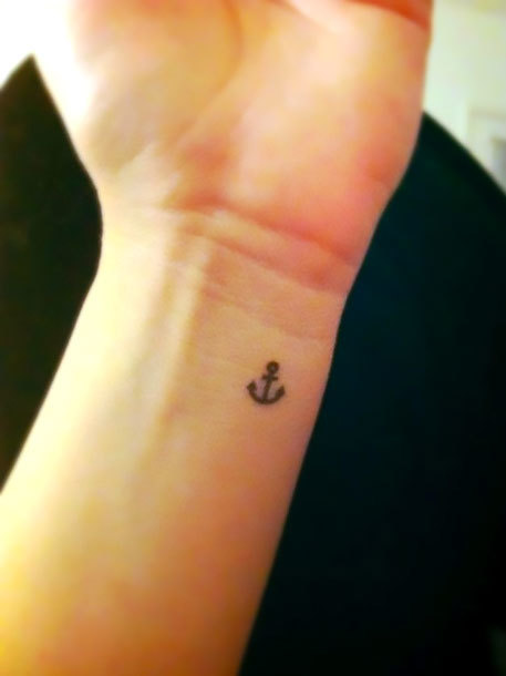 Tiny Anchor on Wrist Tattoo Idea