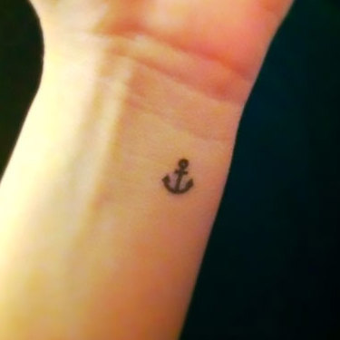 Tiny Anchor on Wrist Tattoo