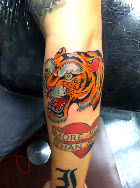 Traditional Tiger on Elbow Tattoo Idea