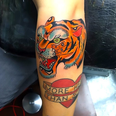 Traditional Tiger on Elbow Tattoo
