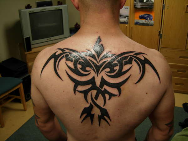 Tribal Crow Tattoo Idea
