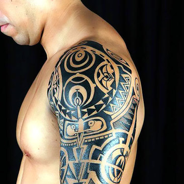 Tribal Men Tattoo