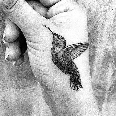 Awesome Hummingbird on Hand Tattoo