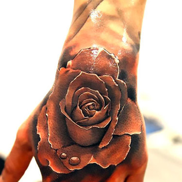 Realistic Rose on Hand Tattoo
