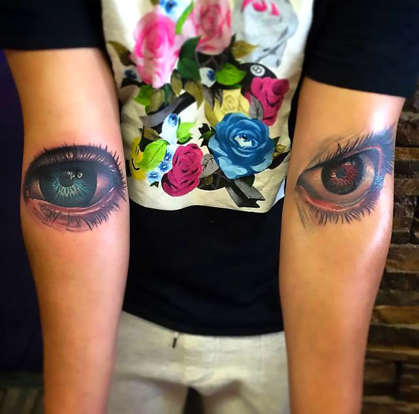 Red and Blue Eyes on Elbow Tattoo Idea