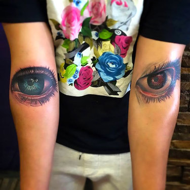 Red and Blue Eyes on Elbow Tattoo