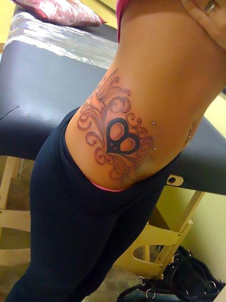 Peace Heart on Hip Tattoo Idea