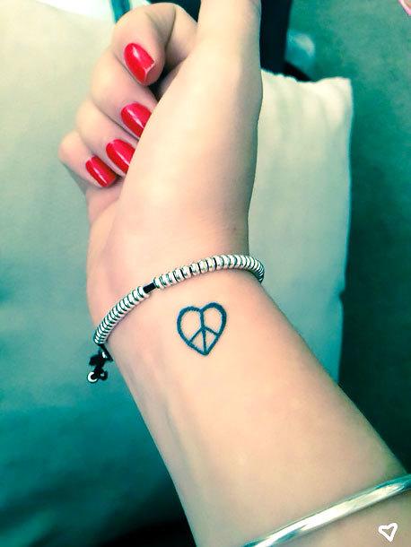 Peace Heart on Wrist Tattoo Idea