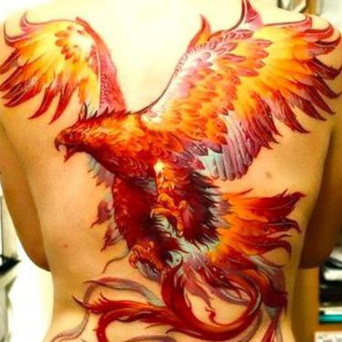 Awesome Phoenix On Back Tattoo