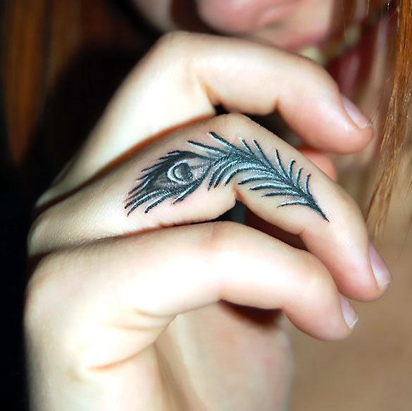 Peacock Feather on Finger Tattoo Idea