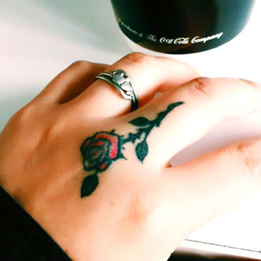Rose on Middle Finger Tattoo