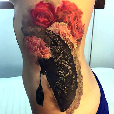 Rose on Ribs Tattoo