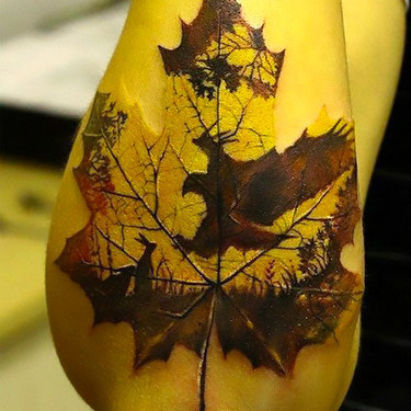 Eagle Shape on Leaf Tattoo