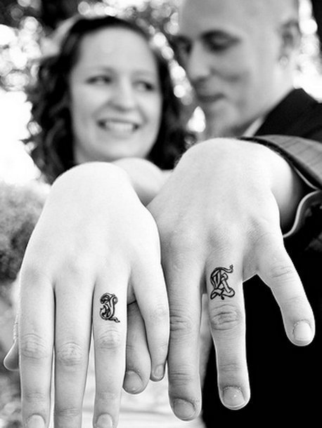 Wedding Letters on the Fingers Tattoo Idea