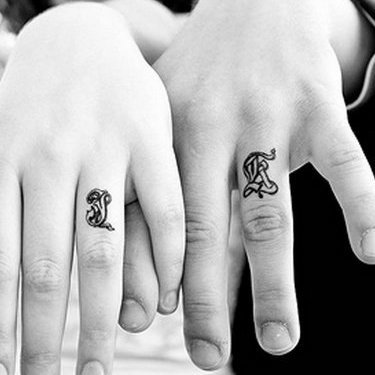 Wedding Letters on the Fingers Tattoo
