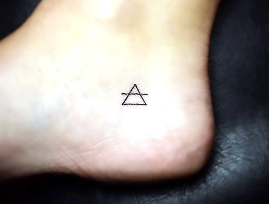 Tiny Triangle Tattoo Idea