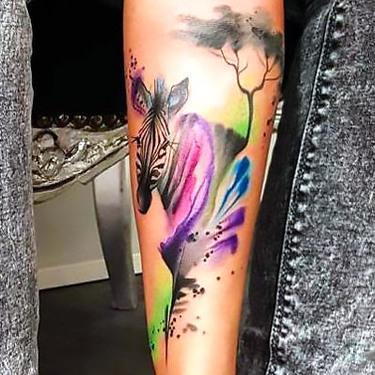 Colorful Zebra on Forearm Tattoo