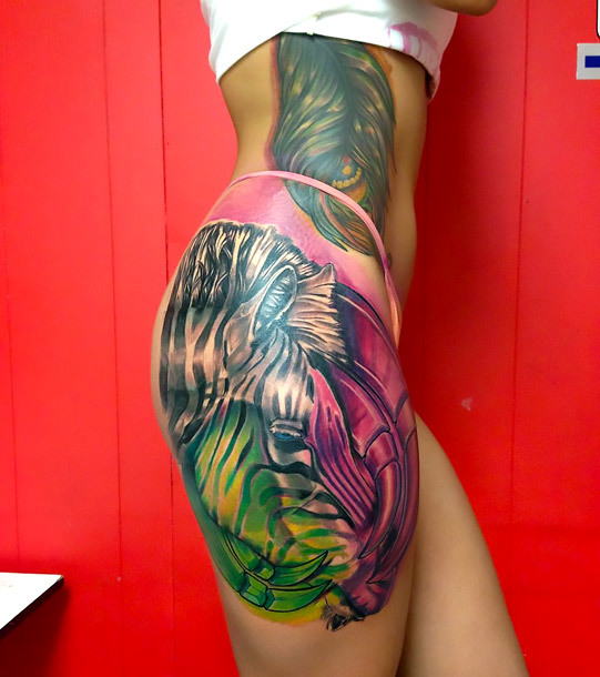 Cool Zebra on Thigh Tattoo Idea