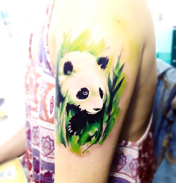 Panda In Grass Tattoo Idea