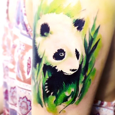 Panda In Grass Tattoo