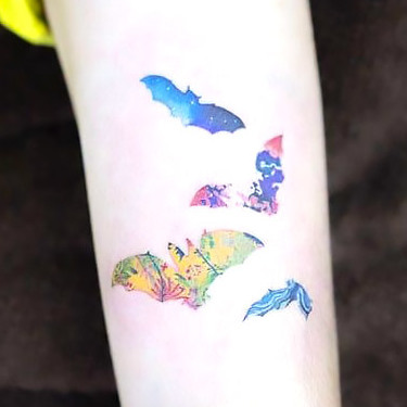 Small Colorful Bats Tattoo