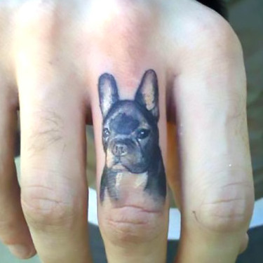 Tiny Bulldog Tattoo on Finger Tattoo