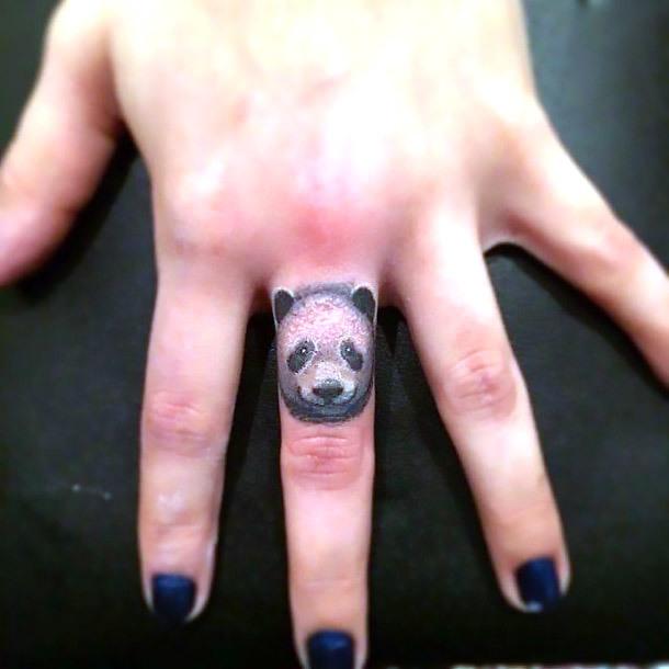 Tiny Panda Tattoo on Finger Tattoo Idea